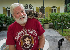 """Wally Collins poses in front of the Ernest Hemingway Home & Museum Sunday, July 20, 2014, in Key West, Fla. Collins, a Phoenix restaurateur, won the 2014 """"Papa"""" Hemingway Look-Alike Contest late Saturday, July 19, at Sloppy Joe's Bar.  The competition was a highlight of Key West's annual Hemingway Days festival that concludes Sunday. FOR EDITORIAL USE ONLY (Andy Newman/Florida Keys News Bureau/HO)"""